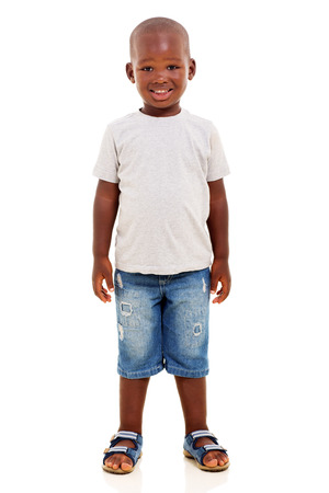 Photo pour happy young african boy standing on white background - image libre de droit