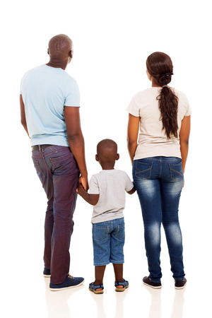 Foto de back view of young african family holding hands isolated on white - Imagen libre de derechos