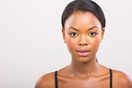 Photo for gorgeous african girl with natural makeup on plain  - Royalty Free Image