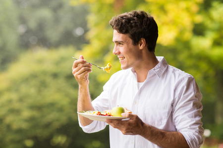 Photo for handsome young man eating scrambled egg for breakfast - Royalty Free Image