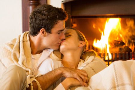 Photo for romantic young couple kissing in living room - Royalty Free Image