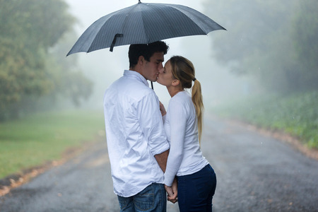 Photo for loving young couple in love under umbrella in the rain - Royalty Free Image