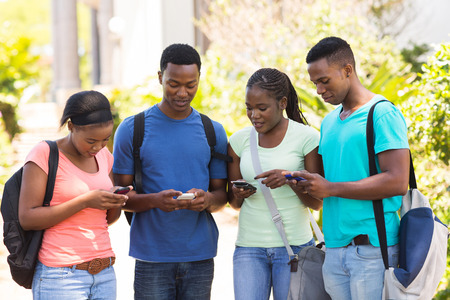 Photo for modern african college student using their cell phones - Royalty Free Image
