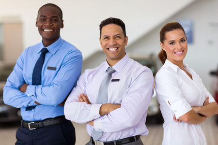 Photo for car sales staff standing inside showroom - Royalty Free Image