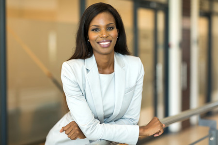 Photo for happy young female corporate worker in modern office - Royalty Free Image