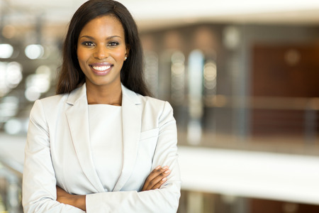 Foto de attractive black business executive with arms crossed - Imagen libre de derechos