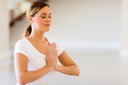Photo for close up of pretty woman doing yoga meditation - Royalty Free Image