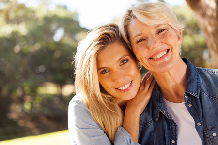 Foto de happy middle aged blond mother and adult daughter outdoors - Imagen libre de derechos