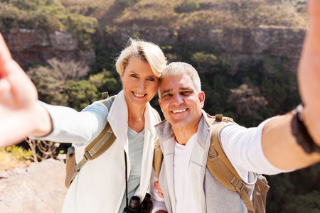 Photo for happy hiking couple taking selfie together on top of mountain - Royalty Free Image