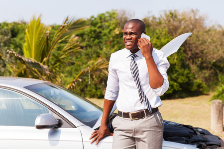 Photo for worried african american man with broken car calling for help - Royalty Free Image