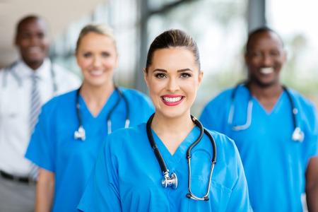 Foto de pretty medical nurse and colleagues in hospital - Imagen libre de derechos