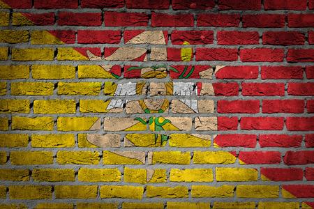 Dark brick wall texture - flag painted on wall - Sicily