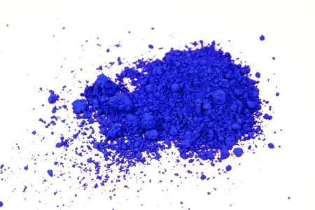 close up of a small portion of ultramarine blue pigment isolated over white