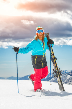 Girl freeride skier, cheerful smiling before the descent from the mountain