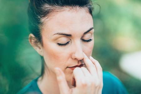 Foto de Breathing exercise Pranayama - Alternate nostril breathing, often performed for stress and anxiety relief - Imagen libre de derechos