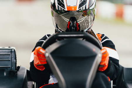 Photo for Woman driving go-cart on a sports track - Royalty Free Image