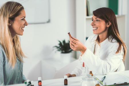 Foto de Homeopathy. Woman visiting a homeopath - Imagen libre de derechos