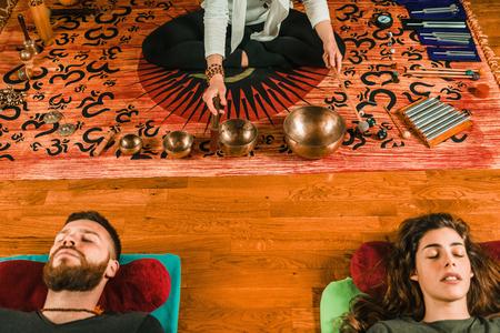Foto de Tibetan singing bowl in sound therapy - Imagen libre de derechos