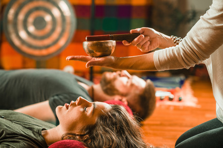 Foto de Tibetan singing bowl in sound therapy - Imagen libre de derechos