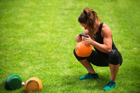 Photo for Female athlete with kettlebells - Royalty Free Image