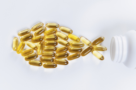 Foto de Omega 3 supplements.  Softgel supplement capsules, fish shape - Imagen libre de derechos