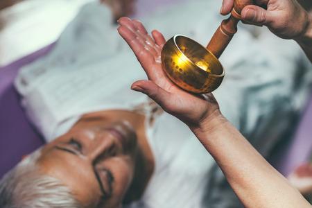Foto de Tibetan singing bowl in sound meditation therapy - Imagen libre de derechos