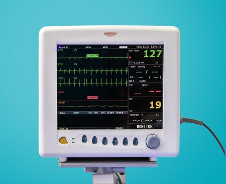 Foto de EKG Monitor in ICU Unit on Blue Background - Imagen libre de derechos