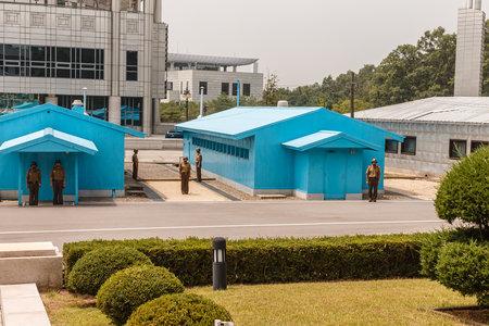 Foto de Panmunjom, North Korea - July 30, 2014: Border between North and South Korea. View from North Korea. The Joint Security Area from the North Korean side. - Imagen libre de derechos