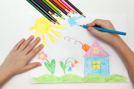 Photo for Child draws a pencil drawing of the world - Royalty Free Image