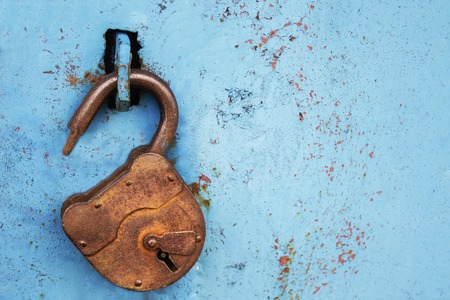 Photo for Old rusty lock without a key on a blue background - Royalty Free Image