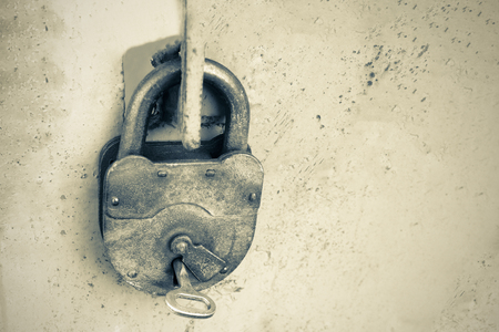 Photo for Old rusty lock with a key on a gray background, black and white photo. - Royalty Free Image