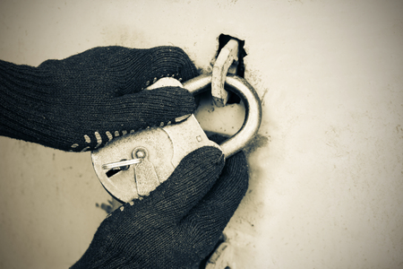 Photo for The thief opens the old lock. Safe storage of property - Royalty Free Image