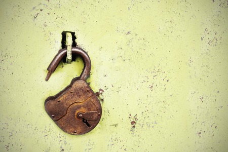 Photo for Old rusty lock without a key on a blue background. - Royalty Free Image
