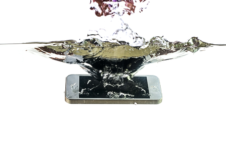 Photo for Smartphone in the water and splash on a white background. Waterproof mobile phone. - Royalty Free Image