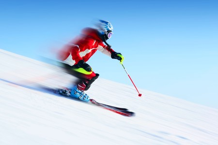 Ski rider in motion. Blurred back and sharp front
