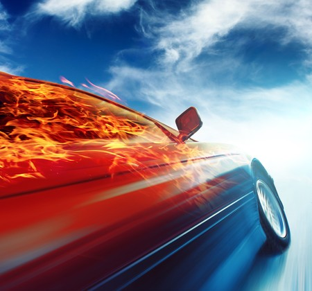 Photo for Burning car in motion over blue sky background - Royalty Free Image