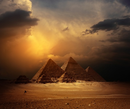 Photo for Great pyramids in Giza valley with yellow dark clouds on the background - Royalty Free Image