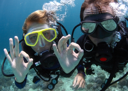 Photo for Scuba divers showing OK signal underwater - Royalty Free Image