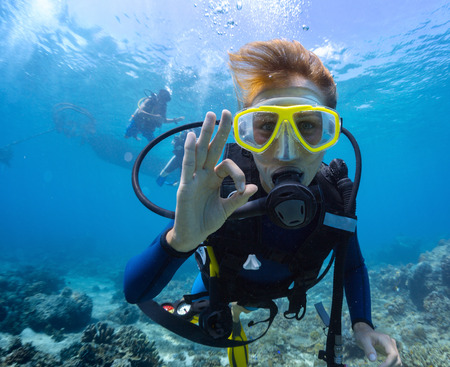 Photo for Female scuba diver underwater showing ok signal - Royalty Free Image
