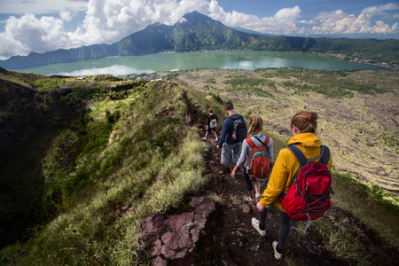 Photo for Group of hikers walking on the caldera of volcano of Batur, Bali, Indonesia - Royalty Free Image