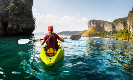 Photo pour Lady paddling the kayak in the calm tropical bay - image libre de droit
