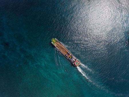 Photo pour Aerial shot of the cargo moving in the sea - image libre de droit