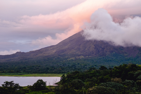 Photo for Volcano of Arenal covered in clouds at sunrise. Costa Rica - Royalty Free Image