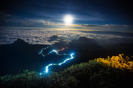 Photo pour Illuminated path to the top of the mountain of Adams Peak with moon and stars in the sky. View from Adams Peak, Sri Lanka - image libre de droit