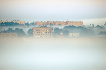 Photo for View of the buildings in the city of Izhevsk in a fog - Royalty Free Image