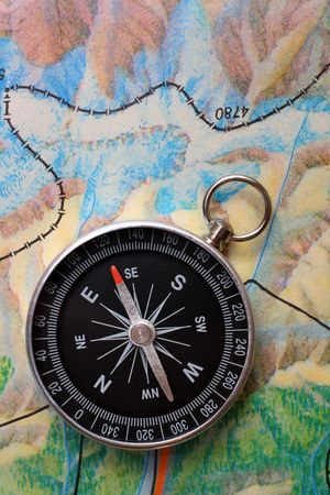 compass on geography map - orientation concept