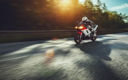 Photo pour man riding motorcycle in asphalt road - image libre de droit