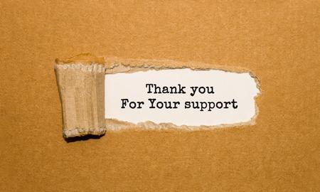 Foto de The text Thank you For Your support appearing behind torn brown paper - Imagen libre de derechos