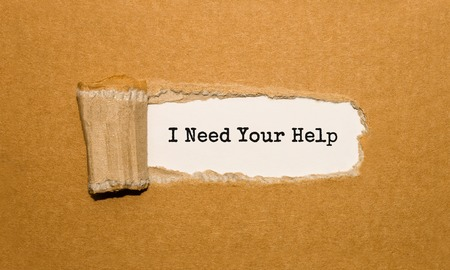 Foto de The text I Need Your Help appearing behind torn brown paper - Imagen libre de derechos