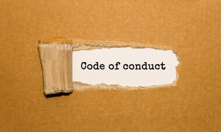 Photo for The text Code of conduct appearing behind torn brown paper - Royalty Free Image
